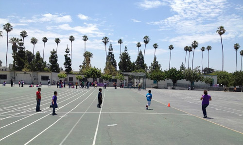 A professional in Los Angeles joins into a kickball game with her students (with a little help from the Remaking Recess program).