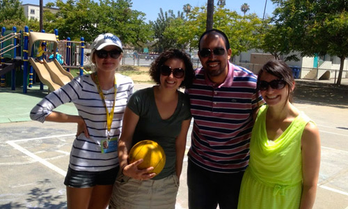Marta, Courtney, Jose and Suzannah take a break to pose for a picture on a scorching summer day on an LA playground.