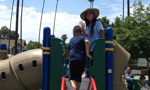 Marcella Mattos from UCLA works the play structure at an LAUSD elementary school.